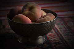 Still Life with Peaches (suzanne~) Tags: stilllife tabletop peach fruit bowl silverbowl orientaltextile chiaroscuro lowkey