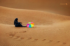 Relaxing after a long walk on Dunes (hisalman) Tags: desert dunes girl lady woman umbrella hot heat dubai razeen abudhabi canon
