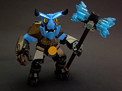 Grommok the Thrasher (Djokson) Tags: demon monster warrrior solidier knight hammer armor blue crystal horns spikes gold iron black djokson lego moc toy model bionicle