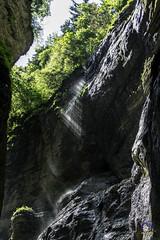 Sunlight on the Waterfall (carolienvanhilten) Tags: garmischpartenkirchen bavaria beieren gorge partnachklamm deutschland duitsland germany waterfall waterval rainbow mountains water