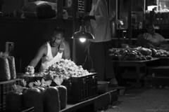 Busy flower vendor (Arun Ramanan) Tags: flower vendor monochrome blackandwhite market koyembedu chennai madras candid arunramanansphotography busy activity streetportrait streetphotography magazine stilllife canon lowlight availablelight