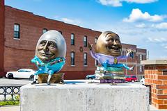 two eggs (royhale71) Tags: springfield missouri mo eggs books downtown september 2017 09 canon 7d mark ii statues statue funny brick concrete legs arms smile pants shoes
