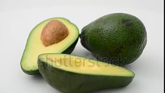 Avocado. For viewing of video follow the link. (daria.boteva) Tags: avocado background brown closeup color cut delicious diet dieting eating exotic food fresh freshness fruit green half health healthy ingredient isolated lifestyle movement nature nutrition organic peel plant portion pulp ripe rough salad section seed slice soft tropical vegetable vegetarian vitamin white