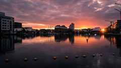 Sunset on Grand Canal Dock - Dublin, Ireland - Cityscape photography (Giuseppe Milo (www.pixael.com)) Tags: liffey sunset ireland reflection buildings cityscape orange red sun canal urban light travel pink grand dublin architecture dock river yellow water city countydublin ie onsale portfolio