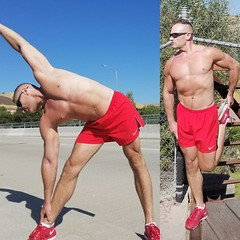 stretching on roadway (ddman_70) Tags: shirtless pecs abs muscle stretching shortshorts