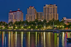 City of West Palm Beach, Palm Beach County, Florida, USA (Jorge Marco Molina) Tags: westpalmbeach palmbeachcounty city cityscape urban downtown skyline southflorida density centralbusinessdistrict skyscraper building architecture commercialproperty cosmopolitan metro metropolitan metropolis sunshinestate realestate highrise royalparkbridge townofpalmbeach palmbeach clearlake reflection reflectiononwater bluehour
