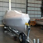 boat shrink-wrapped to transport