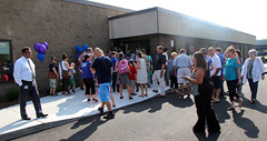 The crowd of over 100 guests started gathering in the parking lot before the event even began. Once the Ribbon Cutting was complete, everyone was welcomed in to see our new school space and visit their child's room.