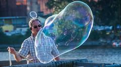 2017 - Vancouver - Bubble Up (Ted's photos - Returns 23 Jun) Tags: 2017 bc britishcolumbia nikon nikond750 nikonfx tedmcgrath tedsphotos vancouver vancouverbc vancouvercity vignetting bubbles blowingbubbles sunglasses cans2s bokeh headphone male man dents teeth
