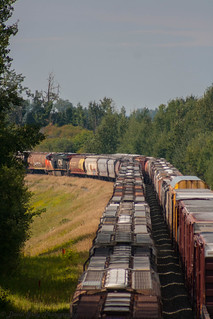 311 rolling westbound by 416 at Carvel, AB