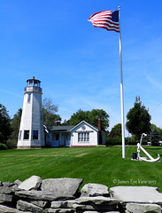 White Rock Memorial Light (JamesEyeViewPhotography) Tags: lighthouse northernmichigan sky trees flag summer michigan jameseyeviewphotography