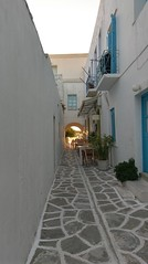 A light at the end of the alley (朱雪薇) Tags: sunset glow alley white blue greece greek paros island
