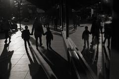 Life reflected (Spotomy) Tags: streetview backlight monochrome shadows silhouttes walk stroll figures afternoon light helsinki finland katunäkymä handinhand streetphotography reflection window street akateeminenkirjakauppa suomi