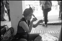 (Final Touch) (Robbie McIntosh) Tags: leicam2 leica m2 rangefinder streetphotography 35mm film pellicola analog analogue negative leicam summilux analogico leicasummilux35mmf14i blackandwhite bw biancoenero bn monochrome argentique summilux35mmf14i autaut dyi selfdeveloped filmisnotdead strangers candid kodaktrix kodak trix fomadonexcel fomadon excel cosplay people woman girl paint makeup mirror