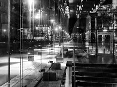 street view through the glass elevator (Eggii) Tags: wrocław street night walk lamps light elevator glass reflections iphone7