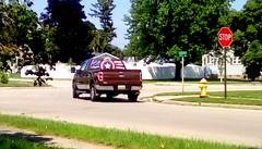Patriotic Pickup - HTT (Maenette1) Tags: patriotic pickuptruck street firehydrant stopsign houses grass trees neighborhood menominee uppermichigan happytruckthursday flicker365 michiganfavorites