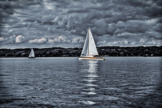 Sailing to the harbour on Lake Constance while the storm is coming nearer, Lindau, Germany
