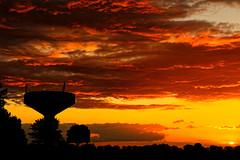 A furnace sky. (alan.irons) Tags: sunset watertower furnacesky fire cloudsstormssunsetssunrises silhouette burtonuponstather hathby westernsky atomspheric burning eos5dmkiv ef2470f28llusm canon england uk skyscape sky northlincolnshire britain