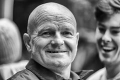 A smile and a half (Frank Fullard) Tags: frankfullard fullard smile happy lol fun candid street portrait monochrome blackandwhite face castlebar mayo irish ireland festival