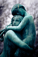 Woman Carrying Sleeping Child (briburt) Tags: vigeland vigelandpark sleeping young woman girl child womancarryingsleepingchild sculpture statue bronze bridge oslo norway travel energy hair green dance frosner art publicart norwegian scandinavian park sad apprehensive fearful bokeh briburt d90