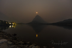 Moon Over Swiftcurrent Lake (rebeccalatsonphotography) Tags: moon predawn haze smoke forestfire spraguefire manyglacier swiftcurrent lake reflection water hotel np glaciernationalpark nationalpark glacier canon 5dsr 14mm prime grinnellmountain moonset