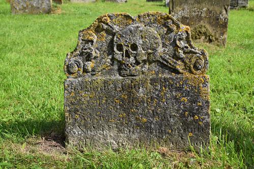skull, crossed bones, scrollwork (18th Century)