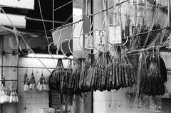 Chinese Sausages (superzookeeper) Tags: eos1 analog film ilford hk hongkong ilforddelta100 delta100 canoneos1 ef2470mmf28liiusm monochrome blackandwhite eos bnw saiwan western chinesesausage market oldhk oldhongkong over1000views street