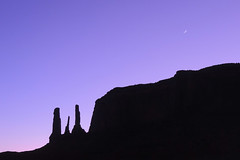 Navajo - Tiny Moon in Purple (Drriss & Marrionn) Tags: travel roadtrip landscape landscapes arizona usa sand outdoor sky skies mountainside mountain buttes naturallight nature countryside navajo stone horizon desert desertplains mothernature canyon canyons rock rocks moon eveninglight