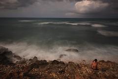 sunbathing vs picture taking (manolo guijarro) Tags: sea seascape human factor humanfactor rocks beach water