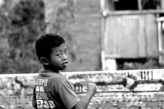 _MG_9832 (Caesar Ramos) Tags: human interest black white bnw child boy play kite turn back head portrait slum rural village cannon eos 7d long lens tele