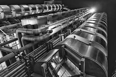 Illuminati (Douguerreotype) Tags: futuristic monochrome buildings lights city night finance lloyds bw uk british england mono blackandwhite architecture britain gb metal london urban dark