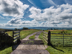 The High Road (scottprice16) Tags: england lancashire aonb forestofbowland summer august high fells longridgefell pendlehill gates grass grid cattlegrid distance view countryside burnslack fuji fujixtrans fujix30 cloud blue weather cumulus vapourtrails