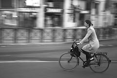 A Bicyclette ! (Ren-s) Tags: bruxelles brussels belgique belgium bike biking vélo bicyclette road route way voie piste cyclable wheels woman femme noiretblanc noir noirblanc nb blackandwhite black blanc blackwhite white street streetphotography rue photographiederue speed vitesse filé city town towncenter ville downtown night soir evening contrast contraste shops magasins coat manteau people personne bnw bw canon eos 600d efs1855mm f3556 is