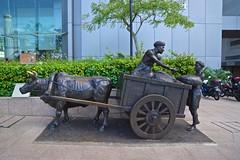 Bronze sculpture beside the Singapore river in the CBD (UweBKK (α 77 on )) Tags: singapore southeast asia island city state urban sony alpha 77 dslr slt bronze sculpture ox oxen cart trade river cbd