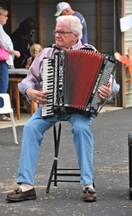 31st Annual Saint Elizabeth Catholic Church Pork Out (rabidscottsman) Tags: scotthendersonphotography accordion music polkaband band musicalinstrument mn minnesota elizabethminnesota sunday weekend man elderly musician catholicchurch catholic parkinglot seated americanpolka abaldoni pianoaccordion people peoplewatching church porkout festival nikon nikond7100 d7100 tamron tamron18270 18270 socialmedia usa unitedstatesofamerica polka verticalformat day232 bluejeans candid capturedmoment