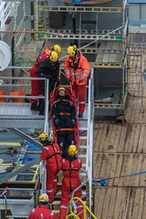 Diver on stretcher (SPMac) Tags: arctic circle barents sea norway eni norge goliat fpso 71227 floating production storage oil gas ldc light diving craft frc fast rescue divers maintenance inspection diver test drill stretcher stairs ladder safety ppe coordination strapped maersk supply rem forza service
