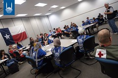 Red Cross and IRUSA DRT Staff and Volunteers get morning briefing