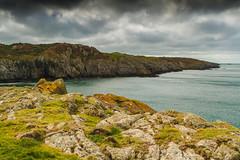 Point Lynas Coast (Howard 'H' Pimborough) Tags: howardhpimborough canon7d 1740mmf4l point lynas anglesey cymru clouds coast sea cliffs cliff waves water wales kayak lighthouse rocks rock f16