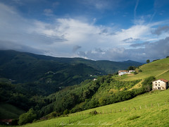 Navarra countryside (Alejandro Hernández Valbuena) Tags: highway driving nature mountains light cold green viewpoint houses basque mountain picturesque trees clouds high navarra village landscape town country forrest picks navarre panorama sunset etxalar countryside
