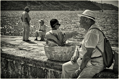 Hats And Cigarettes (Alfred Grupstra) Tags: people men cultures blackandwhite fisherman outdoors poverty asia water old fishing travel river sea senioradult sitting developingcountries males nature indigenousculture montenegro sparkling