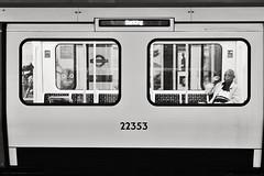 Barking Bound (Douguerreotype) Tags: train monochrome underground city bw window uk metro british mono gb blackandwhite england candid urban britain london subway people glass tube