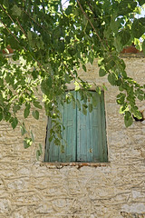 the window (@Katerina Log) Tags: window colour wall rock wood foliage outdoor architecture house sonyilce6000 finestra katerinalog summer stoupa streetphotography village messinia mani peloponnese griechenland greece grecia epz18105mmf4goss