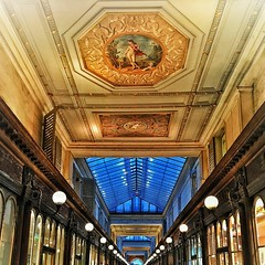 Paris France  ~ Le Passage des Princes ~ Former Arcade (Onasill ~ Bill Badzo ~~~~ OFF) Tags: 97 rue de richelieu victorian arcade le passage des princes paris france downtown historic monument landmark onasill baron haussmann mural well light skylight 1860 banker grand hotel pedestrians stores la vie moderne impressionists wonderland passageway toys shop toy large fixture ceiling 1001nights 1001nightsmagiccity