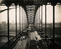 Looking along the Tyne Bridge from Gateshead (Tyne & Wear Archives & Museums) Tags: tynebridge tyneside northeastengland bridges newcastleupontyne gateshead civilengineering blackandwhitephotograph girders construction iconic rivertyne cranes interesting workers guildhall quayside industrialheritage industry digitalimage archives infrastructure buildings city urban river bank land window wall roof sky unitedkingdom buildingthetynebridge development structure progress progression fascinating compelling unusual impressive roadway 22may1928 view newcastle landmark bridge crossing rail debris jamesbaconsons march1927tooctober1928 jamesgeddie chiefassistantengineer dormanlongcoltd middlesbrough grain blur mark label vessel chimney water pipe rope road train timber crane clock sign letter number identification