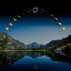Solar Eclipse over Fremont Lake (Jens Lambert Photography) Tags: wind pine mirror water pinedale moon panorama timelapse trees blue sun solar river eclipse refelction calm sky fremontlake wyoming wy wilderness mountain
