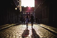 promises, promises (ewitsoe) Tags: man woman walking sunset sun summer guyandgirl couple date night canon 50mm street urban cityscape ideal oldmarket poznan oland colorful flare people walk ewitsoe erikwitsoe poland polska sunny