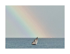 At the End of the Rainbow (The Spirit of the World ( On and Off)) Tags: rainbow colors sky morning rain dhow boat sailing ocean seascape indianocean horizon zanzibar tanzania eastafrica africa nature island
