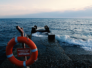 Lifebuoy and life jacket on the pier