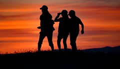 'Cap in hand' (Christie : Colour & Light Collection) Tags: silhouette bc britishcolumbia canada kids children people sundown glow summer capinhand sky evening brilliant cap hat three trio