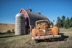 1919 (Elainе) Tags: palouse truck orange barn red
